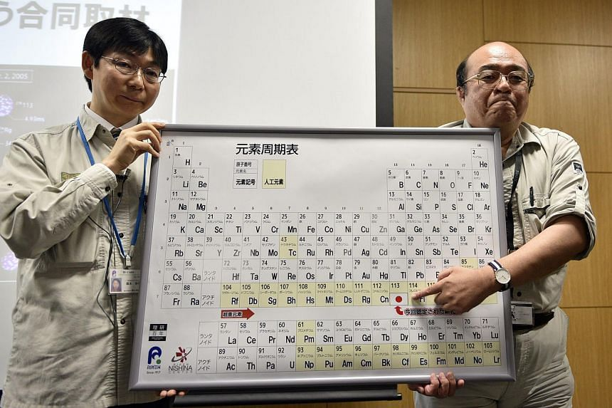 RIKEN's Superheavy Element Production Team group director Kosuke Morita (right) and team leader Koji Morimoto discovered the atomic element 113 and decided to name it Nihonium.