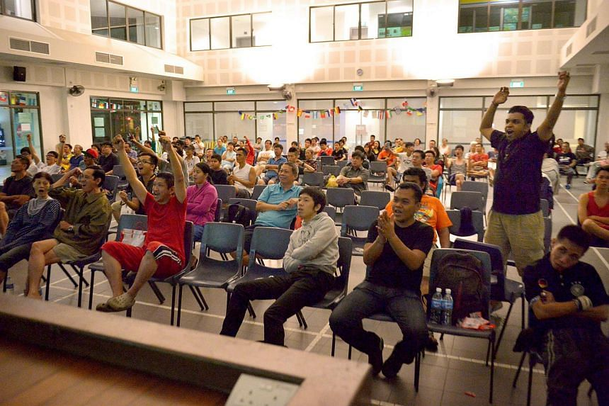 Fans at Bedok Community Centre watching Germany take on Brazil during the 2014 World Cup semi-final.