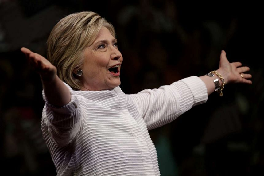 Hillary Clinton gestures to her supporters in Brooklyn, New York, on June 7, 2016.