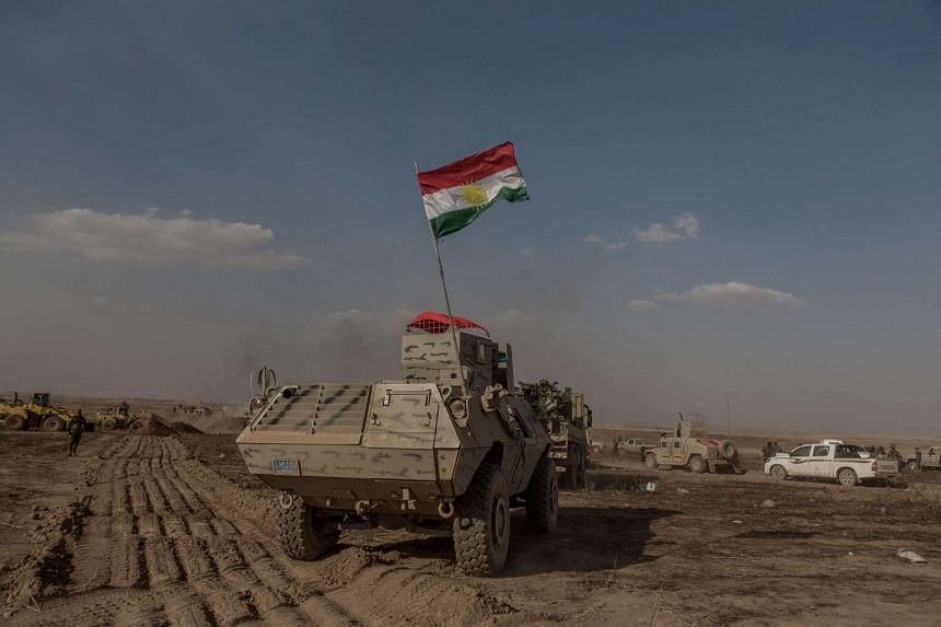Kurdish Peshmerga forces moving in to Mufti village after it was recaptured from Islamic State, Kurdistan region, north Iraq, on May 29.