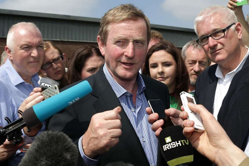 Ireland's Prime Minister Enda Kenny (centre) said on Friday (June 10) that he is open to meeting Donald Trump but he would use the opportunity to him that his views are racist.