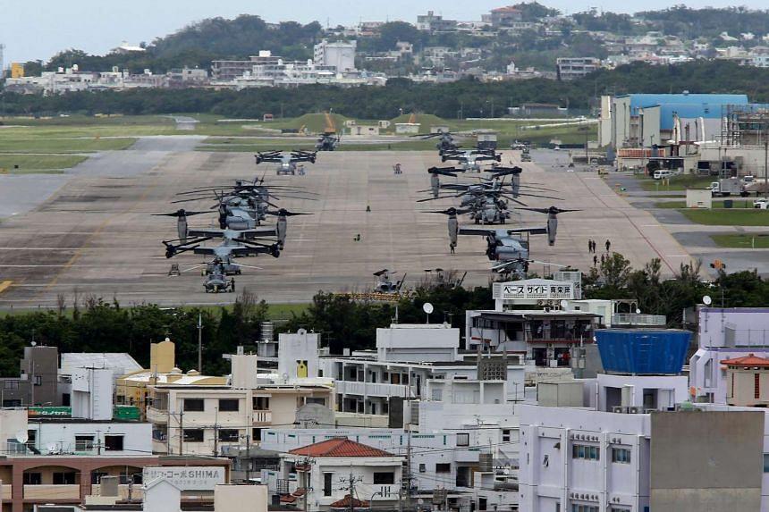 US Marine Corps MV-22 Osprey aircrafts sitting on the tarmac at US Marine Corps Air Station Futenma on Okinawa Island, on May 19, 2015.