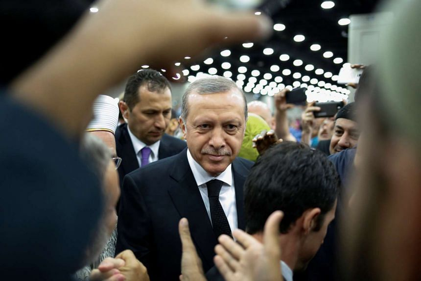Turkish President Tayyip Erdogan arrives to take part in the jenazah, an Islamic funeral prayer, for the late boxing champion Muhammad Ali in Louisville, Kentucky, on June 9, 2016.