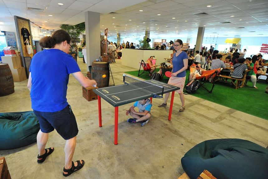 Participants playing table tennis on the second day of the Singapore Coffee Festival, on June 10, 2016.