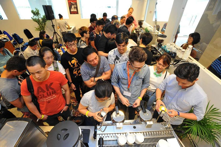 Participants of Fundamentals of Latte Art at CMCR lab on the second day of the Singapore Coffee Festival, on June 10, 2016.