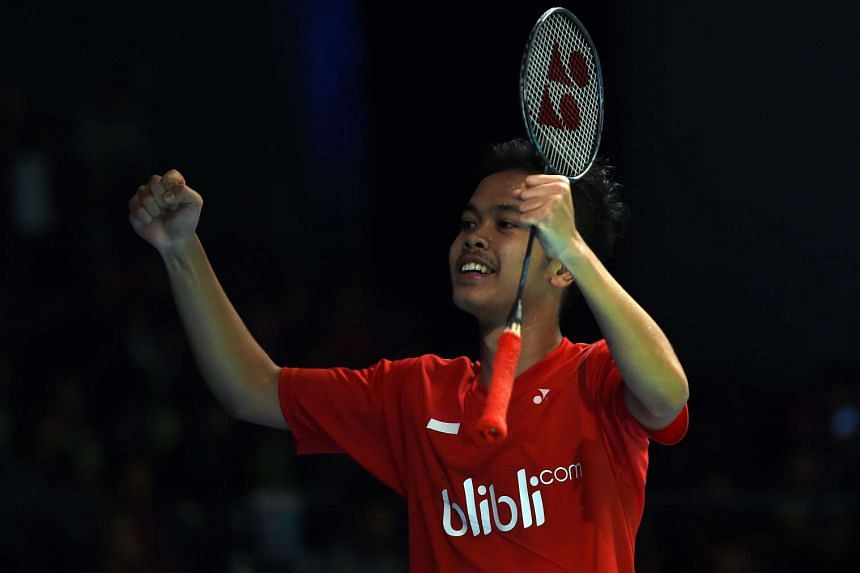 Anthony Sinisuka Ginting celebrates his victory against Chen Long in their men's singles quarter-final at the Australian Badminton Open, on June 10, 2016.
