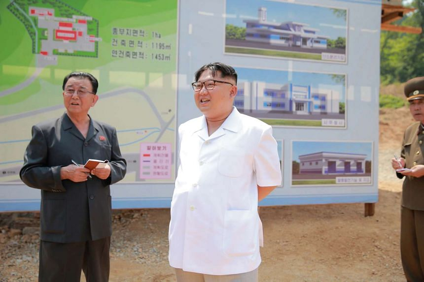North Korean leader Kim Jong Un (center) gives field guidance to the construction site of a medical oxygen factory on May 30.