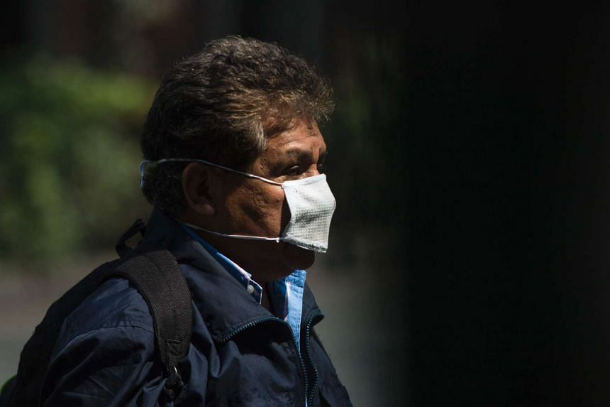 A man wearing a mask against air pollution in Mexico City on June 8.