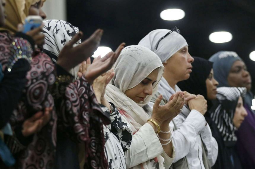 Women attend the jenazah, an Islamic funeral prayer, for the late boxing champion Muhammad Ali.