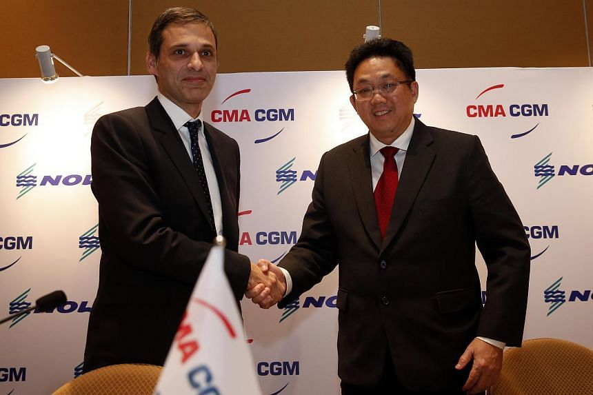 CMA CGM vice-chairman Rodolphe Saade (left) with Nepture Orient Lines chief executive Ng Yat Chung at a press conference on Dec 7, 2015, to announce the buyout.