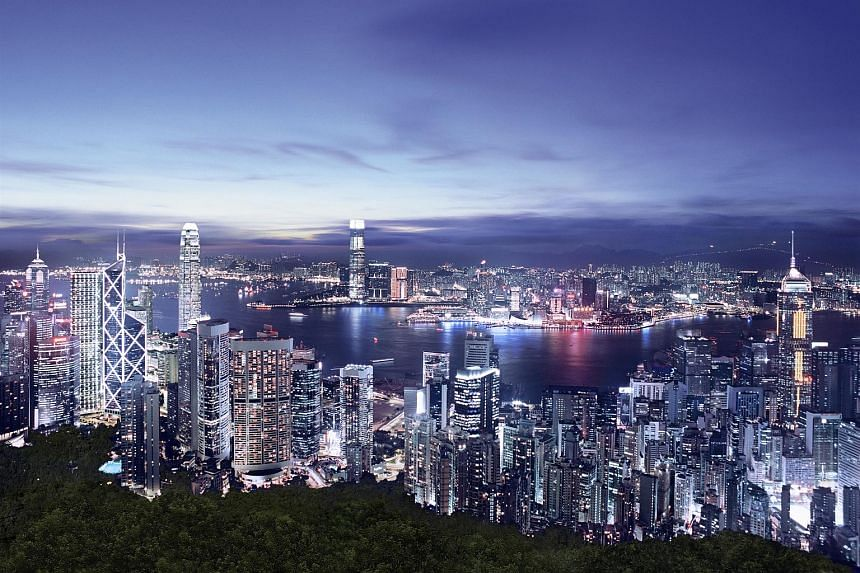 A scenic view of the Hong Kong skyline. While Hong Kong is rising on world rankings for competitiveness, Singapore is sliding, according to a report by a Swiss business school.