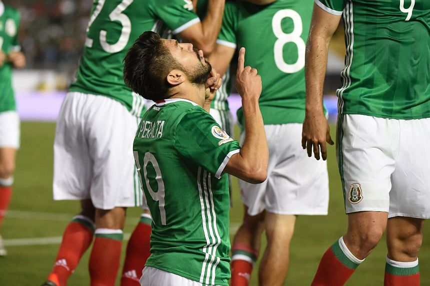 Mexico's Oribe Peralta praying after scoring against Jamaica.