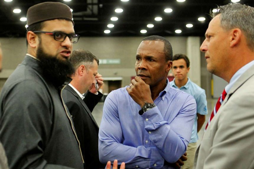 Sugar Ray Leonard (centre) talks with people taking part the jenazah service.