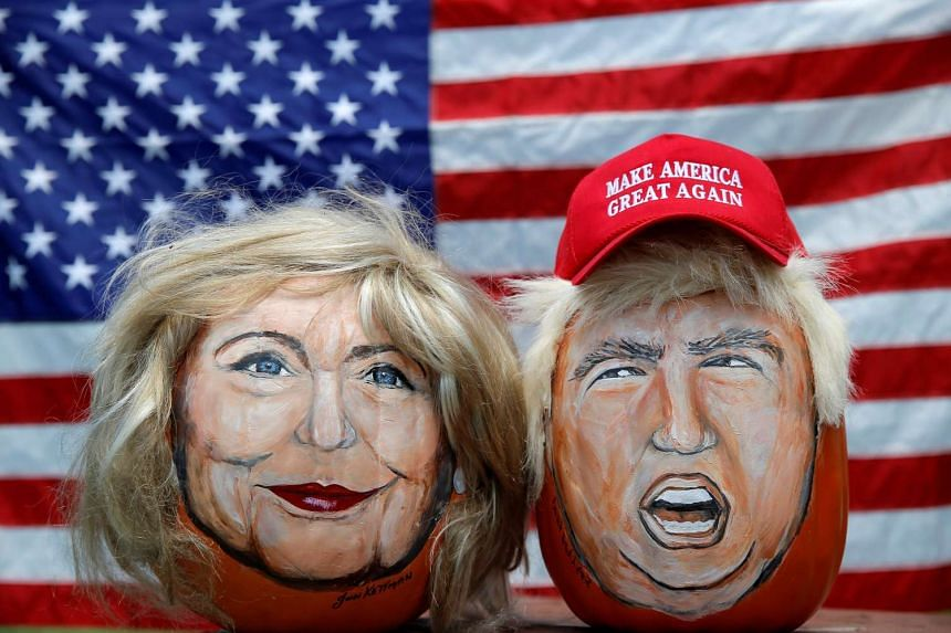 Images of Hillary Clinton and Donald Trump painted on decorative pumpkins created by artist John Kettman in LaSalle, Illinois, June 8, 2016.