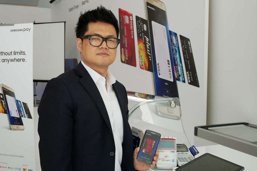 Mr Thomas Ko, vice-president and global general manager of Samsung Pay, with a supported Samsung Pay smartphone.