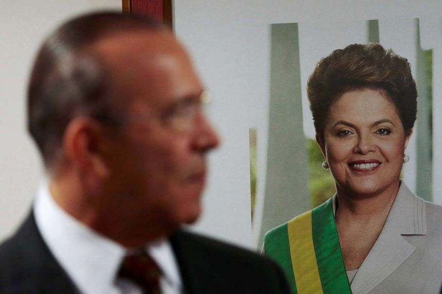 Brazil's Presidential Chief of Staff Eliseu Padilha looking on in front of a portrait of suspended President Dilma Rousseff during ministerial meeting to discuss the 2016 Rio Olympics, at the Planalto Palace in Brasilia, Brazil, on June 7, 2016.