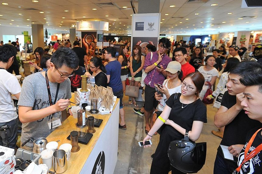 Mr Takayuki Miyazaki, 27, a barista from The Local Coffee Stand in Tokyo, Japan, showing his skills at the Good Coffee Tokyo booth on the second day of the Singapore Coffee Festival yesterday. 	The booth, featuring award-winning Japanese baristas, sh
