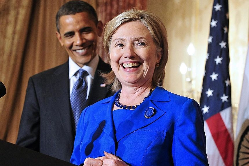 Vice-President Joe Biden (above) and Massachusetts Senator Elizabeth Warren were among other heavyweights who endorsed Mrs Clinton. Mr Obama asked voters to unite behind Mrs Clinton, his former secretary of state, and fight for American values. Polit