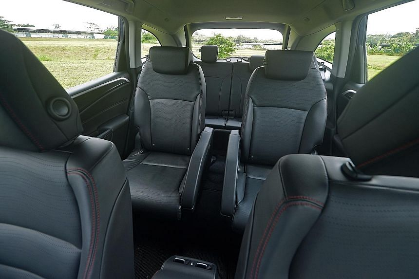 The six-seater Honda Jade (left) has a cosy cabin with premium fit and finish (right) and a third row (above) that can be flipped down to transport bulky items.