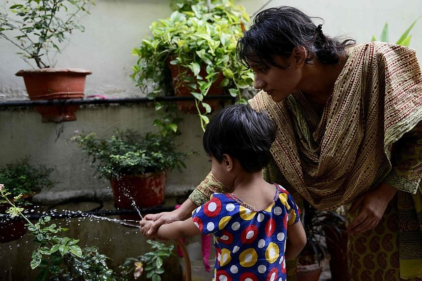 "Ms Mehmood, 31, and her three-year-old daughter Maisha at home in Bhopal on April 28. Her then husband divorced her by scrawling ""talaq"" in Arabic three times in a letter posted to her parents' home."