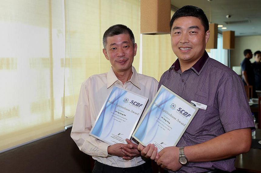 The SCDF encourages members of the public and transport operators to emulate the selfless actions of Mr Ong (far left) and Mr Jiang. The cabby and bus captain were given the Public Spiritedness Award by the Singapore Civil Defence Force yesterday.