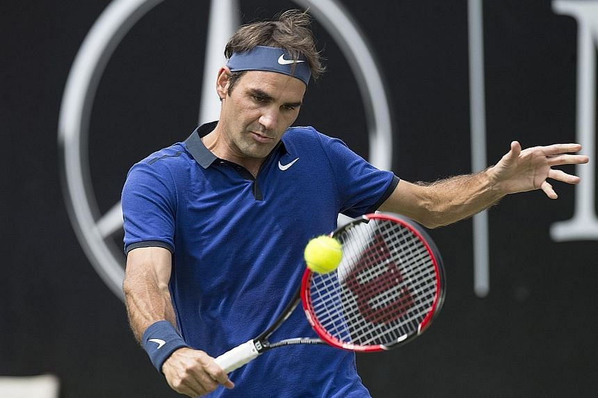 Swiss maestro Roger Federer hits a backhand return to German Florian Mayer. The world No. 3 won their Mercedes Cup quarter-final narrowly as his recovery continues to pick up steam. He had missed the French Open owing to a back injury.