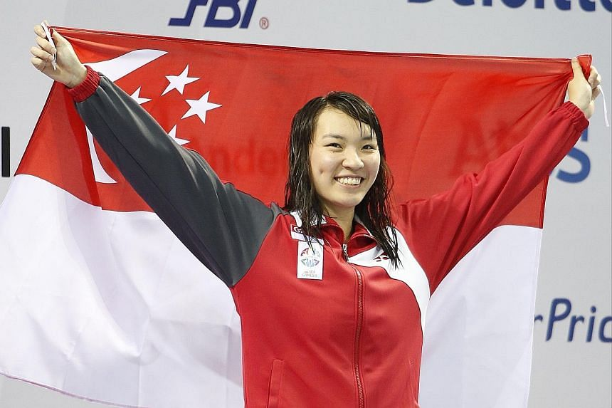 Roanne Ho on the podium a year ago after winning the 50m breaststroke at the SEA Games. Despite her latest setback, which will put her out for the rest of the year, she is determined to return and defend her title in Kuala Lumpur.
