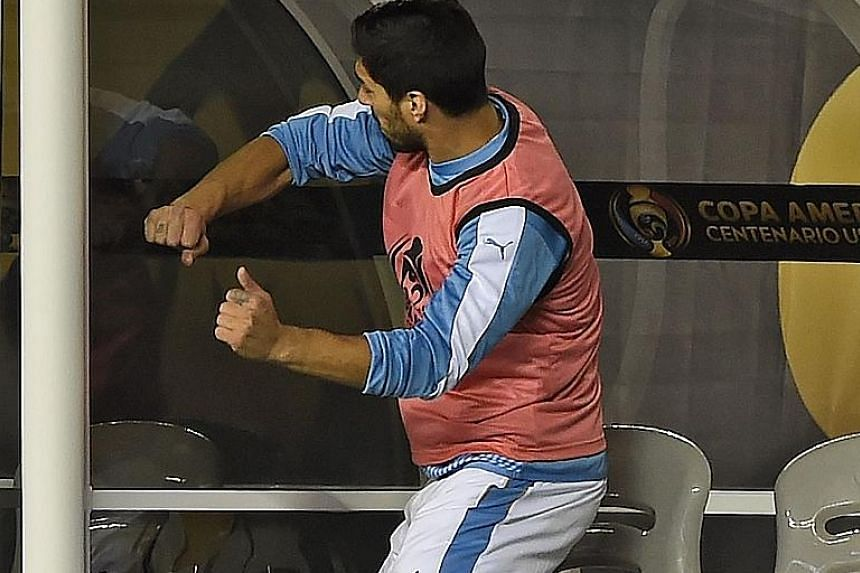 Uruguay's Luis Suarez punching the side of the dugout as he could only watch his team lose to Venezuela and be eliminated from Copa America Centenario.