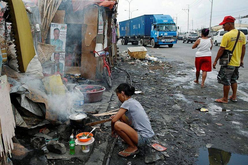 Air pollution which can arise from traffic fumes or cooking fires, such as this one in a Manila shanty town, ranks among the top 10 causes of stroke, along with better-known risks such as smoking, high blood pressure and obesity.