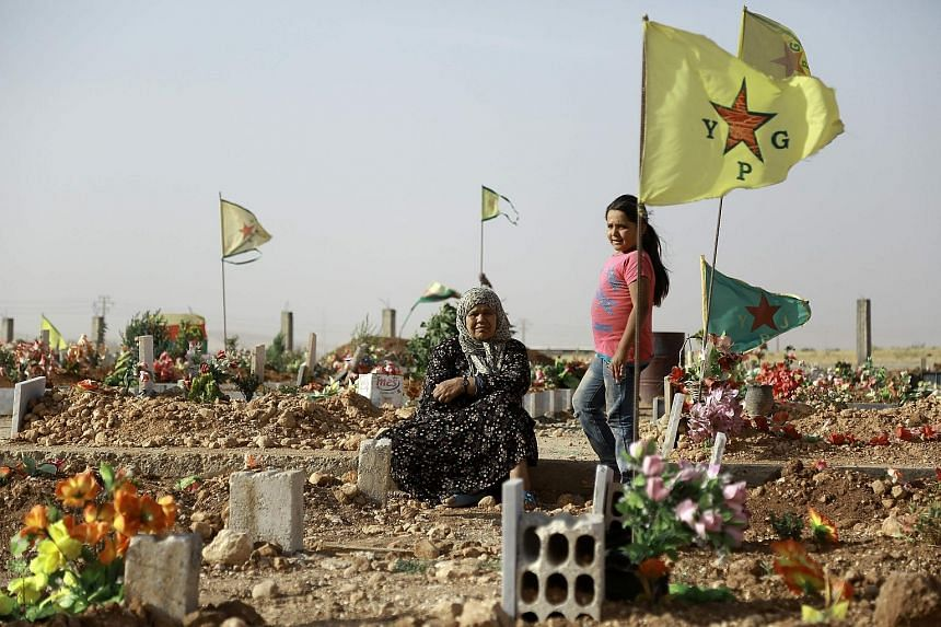 Mourners at the funeral of fighters who died during an assault launched by Arab and Kurdish forces against ISIS in the town of Manbij last week.