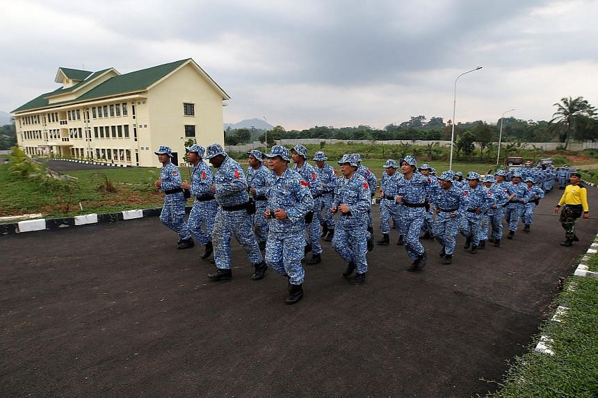 Participants in the Bela Negara, or Defend the Nation, programme jogging at a training centre in Rumpin, Bogor, West Java, earlier this month. A military spokesman has revealed that the programme in Bali will be the first to include the training of s