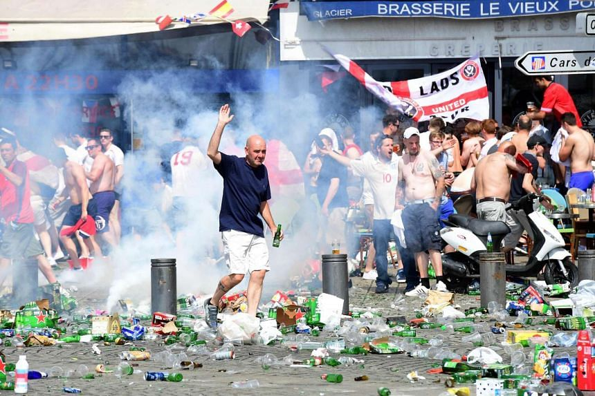 Tear gas is fired at England fans as they gather in the city of Marseille, southern France, on June 11, 2016.