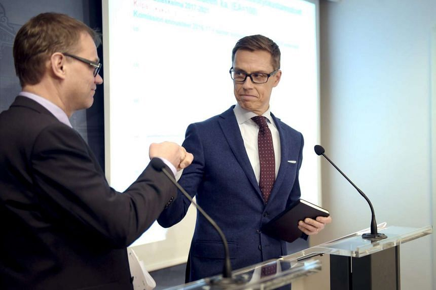Finland's Finance Minister Alexander Stubb (right) at a news conference in the Prime Minister's official residence Kesaranta in Helsinki, on March 2, 2016.
