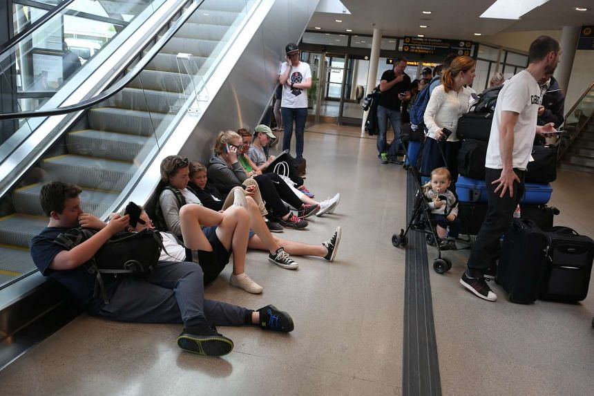 Passengers wait for flight information at the Arlanda Airport's domestic terminal in Stockholm, Sweden, on June 10, 2016.