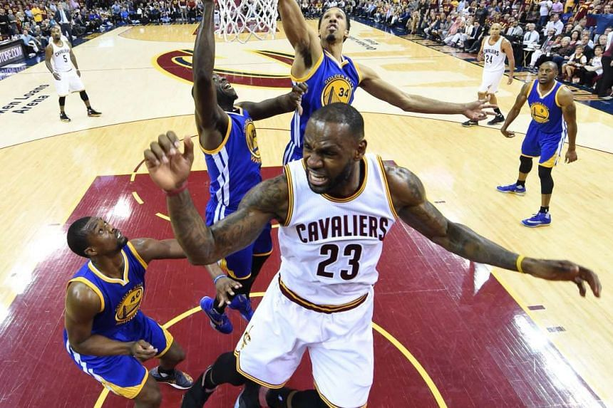 Cleveland Cavaliers' LeBron James is fouled while going to the basket against the Golden State Warriors in the NBA finals Game 4, on June 10, 2016.