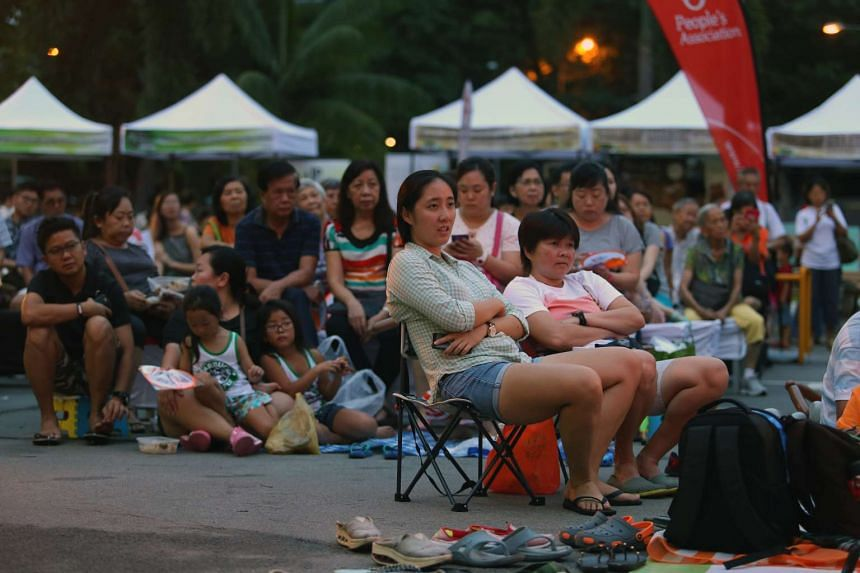 People watching an outdoor screening of Singapore-made films at the Tanjong Pagar Railway Station, on June 11, 2016.