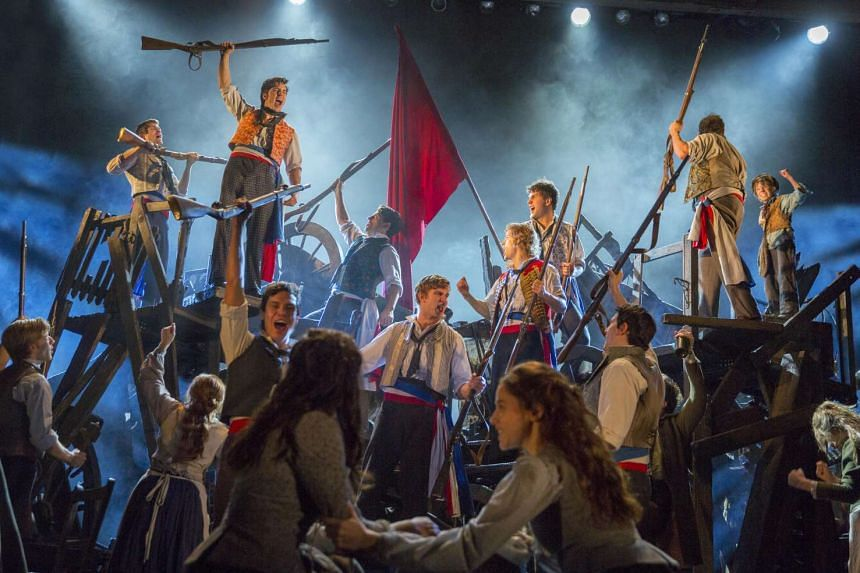 A scene from Les Miserables where students revolt.