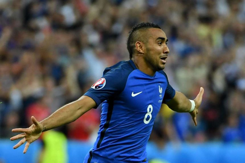 Dimitri Payet of France celebrates scoring the 2-1 lead.