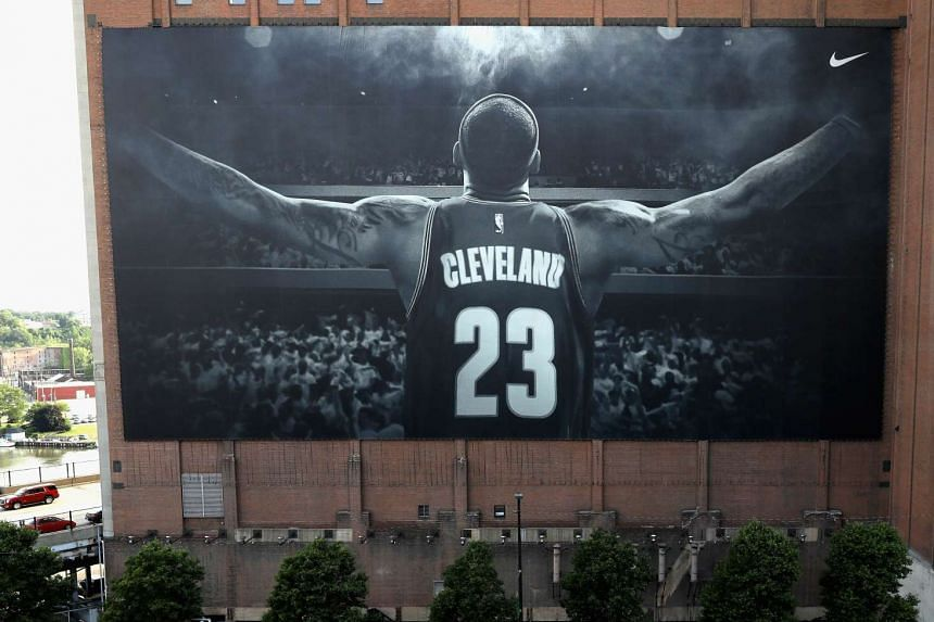 A giant portrait of Cleveland Cavailers superstar LeBron James banner covers  the exterior of the Sherwin-Williams Co. Global Headquarters across from Quicken Loans Arena.