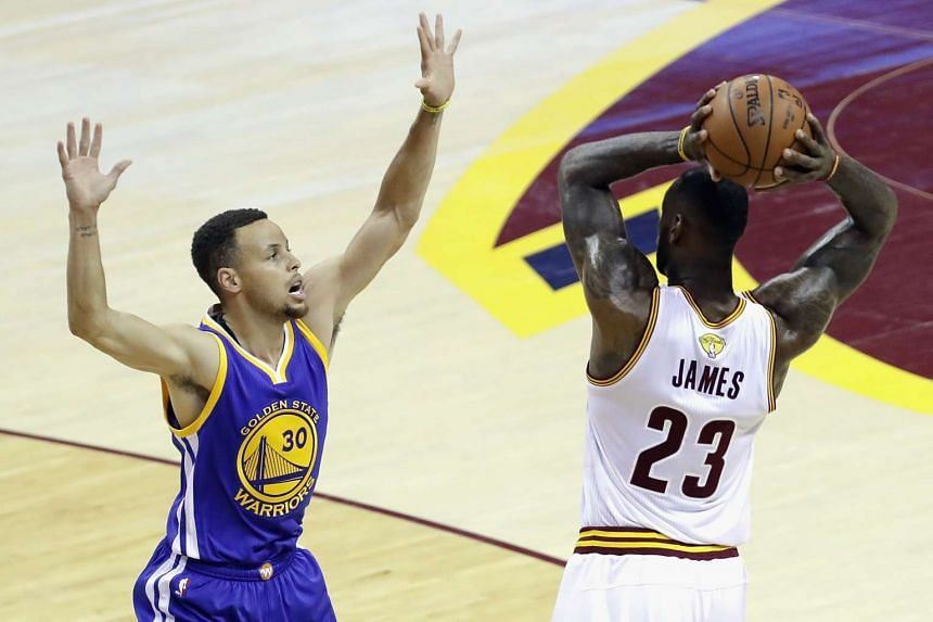 LeBron James #23 of the Cavaliers handles the ball against Stephen Curry #30 of the Golden State Warriors during the first half in Game 4 of the 2016 NBA Finals.