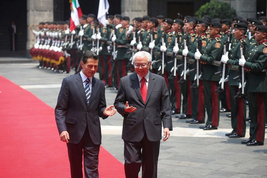 President Tony Tan (right) inspecting the guard of honour at the Palacio Nacional with Mexican President Enrique Pena Nieto.