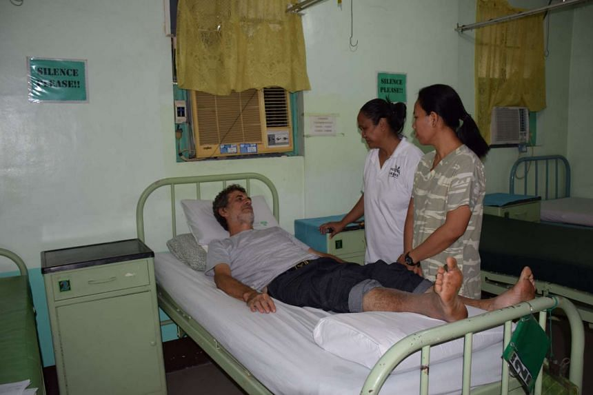Retired Italian priest Rolando Del Torchio (on bed) receiving treatment at a military hospital in Zamboanga City, in Mindanao, on April 9, 2016.