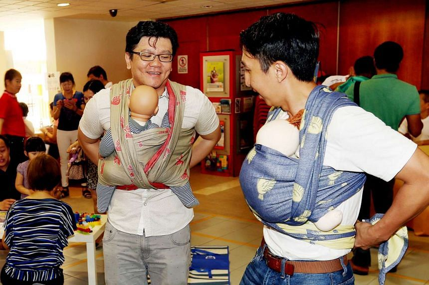 (From left) Mr Lim Wee Hian and Mr Khu Jia Vui during a baby-wearing exercise at Henderson Community Club.
