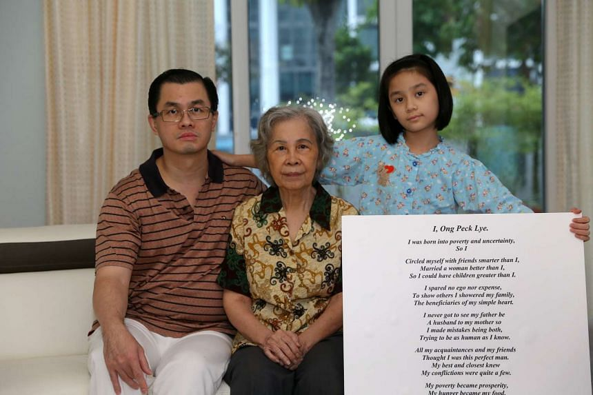 Mr Ong Tiong Yeow with his mother Madam Han Boon Keng and his daughter Andromeda Wang, with a copy of the poem he wrote for his father's obituary.