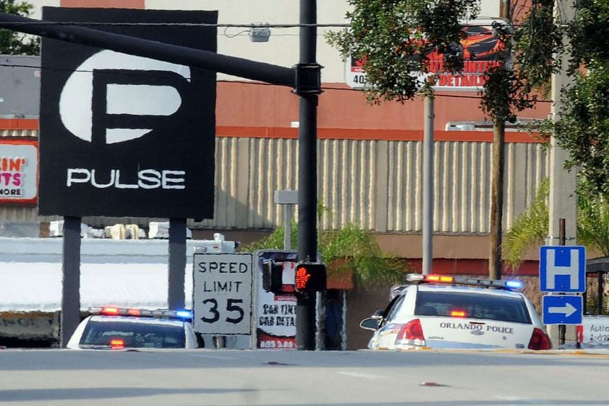 Orlando police officers seen outside of Pulse nightclub after a fatal shooting and hostage situation on June 12, 2016, in Orlando, Florida.