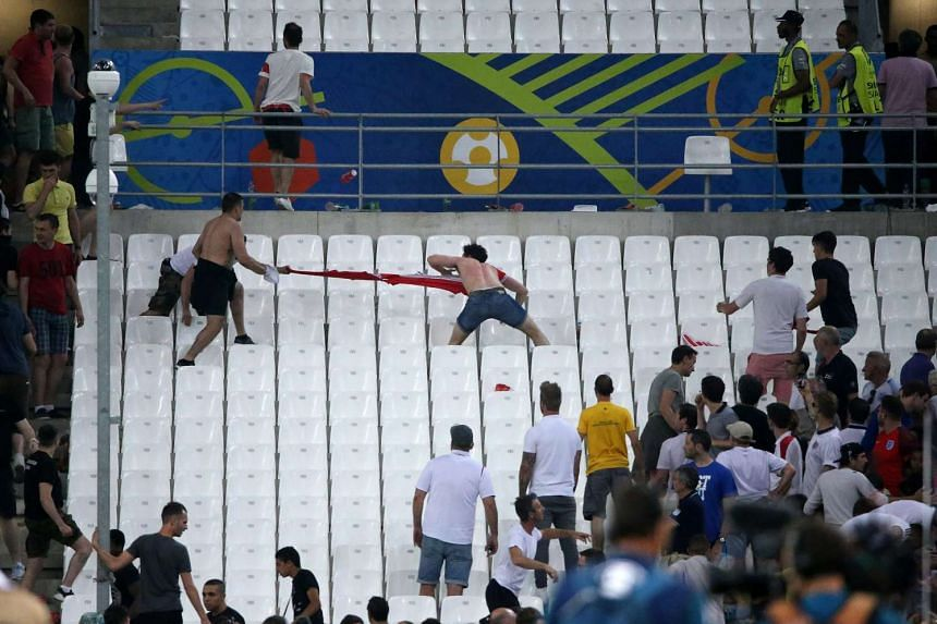 Supporters clash in the stands during the UEFA EURO 2016 group B preliminary round match between England and Russia at Stade Velodrome in Marseille, France on June 11, 2016.