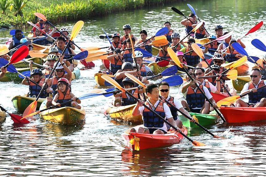 Mr Ong Ye Kung (foreground, centre), who is Acting Minister for Education (Higher Education and Skills) and Senior Minister of State for Defence, participating in the inaugural Safra Punggol Waterway Challenge.