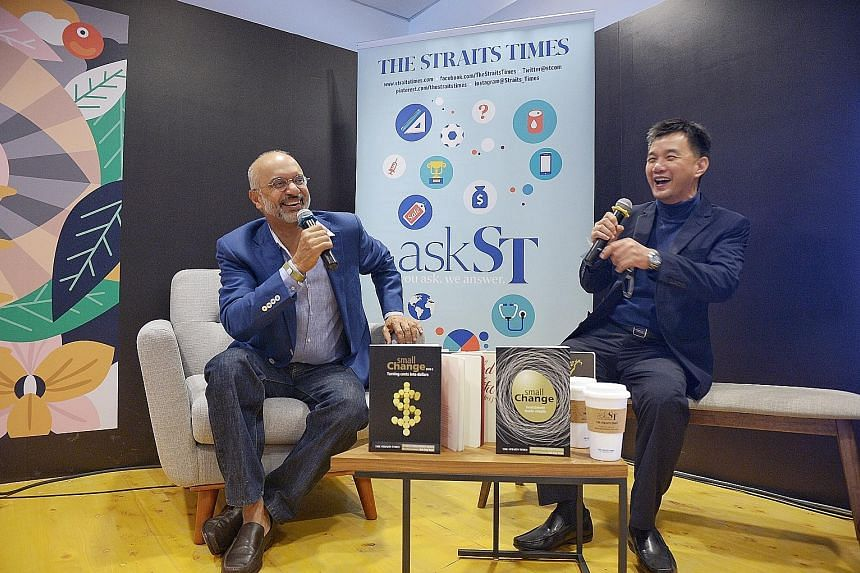Mr Gupta (left) and Mr Goh sharing a light-hearted moment in the ST Reading Room yesterday. Over 100 people gathered to hear Mr Gupta's insights on issues such as investment and the state of the world economy.