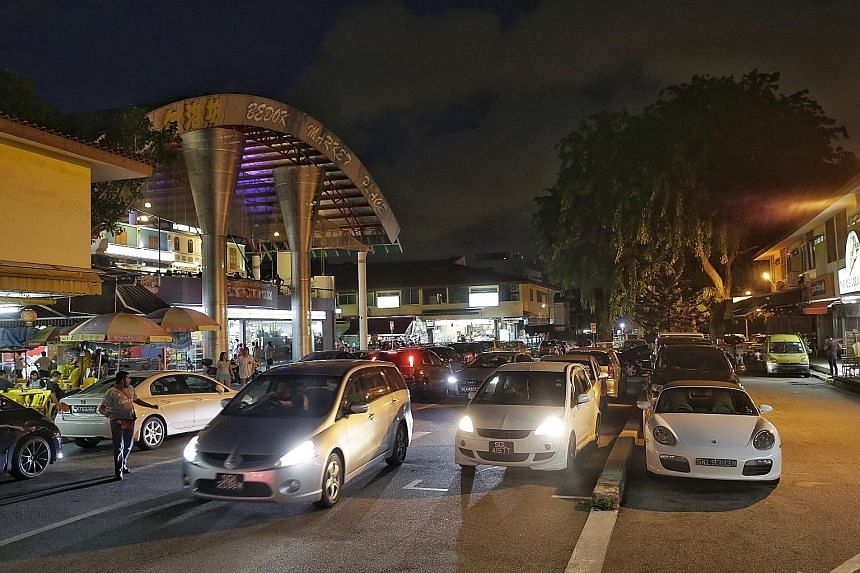 The carpark at Simpang Bedok was full at dinner time last night, with cars circling repeatedly as customers hunted for a parking space.