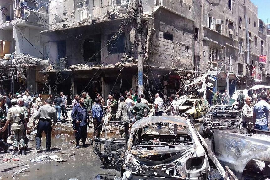 ISIS militants in Damascus detonated an explosives-laden car outside the Sayyida Zeinab shrine, which is revered by Shi'ites, yesterday.